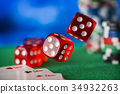 Red dice rotates in the air, casino chips, cards 34932263