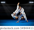 Boys martial arts fighters in sports hall 34944411
