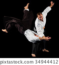 Two martial arts fighters 34944412