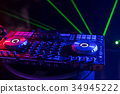 DJ is rhythm music with Controller and mixer. 34945222