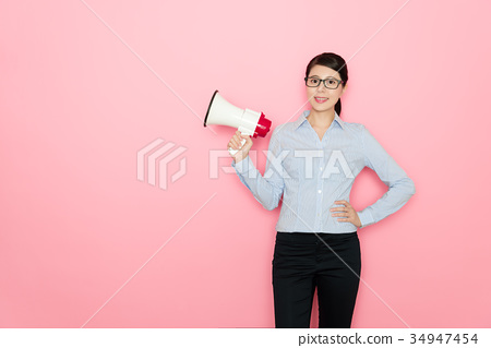 smiling pretty business woman holding loudspeaker 34947454