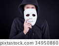 Mystery man holding white mask for hide his face 34950860