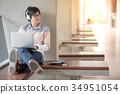 Young Asian student man using laptop in college 34951054