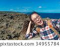 girl backpacker going to ocean island travel 34955784
