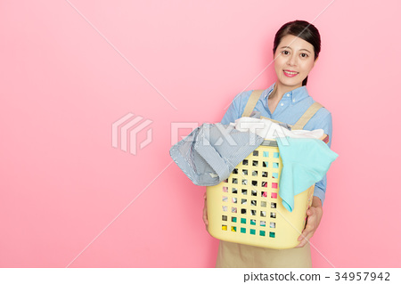 smiling housewife standing in pink background 34957942
