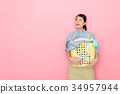 woman houseworker standing in pink background 34957944