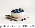 Juicy and fresh blueberries on white bowl 34960526