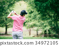 Middle men playing golf 34972105