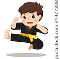 A cute boy showing his karate moves. 34972808