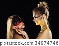 Two mystic girls. Halloween horror ladies. 34974746