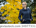 pretty young caucasian girl fashion dress outdoor 34977331