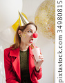 woman at a party on the background of balloon 34980815