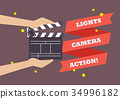 Hands holding movie clapper board 34996182