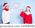 couple smile with merry christmas 34998680