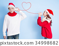 couple smile with merry christmas 34998682
