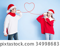 couple smile with merry christmas 34998683