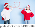 couple smile with merry christmas 34998684