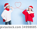 couple smile with merry christmas 34998685