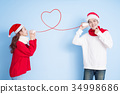 couple smile with merry christmas 34998686