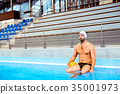 Water polo player in a swimming pool. 35001973