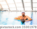 Water polo player in a swimming pool. 35001978