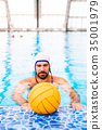 Water polo player in a swimming pool. 35001979