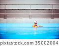 Water polo player in a swimming pool. 35002004
