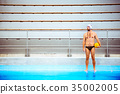 Water polo player in a swimming pool. 35002005