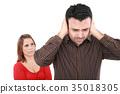 Couple having an argument. Focus on man 35018305