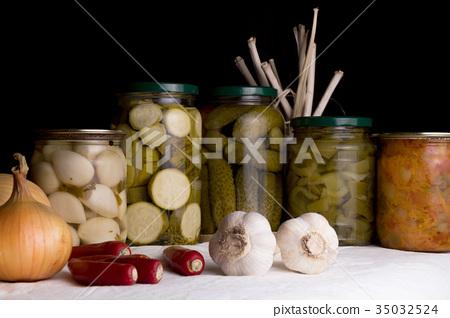 Jars with pickled vegetables on dark background 35032524