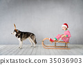 Happy child and dog on Christmas eve 35036903
