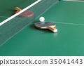 Two table tennis or ping pong rackets and balls on 35041443