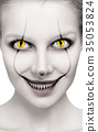 Scary female face with helloween horror grimm. 35053824