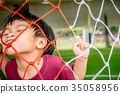 Boy playing with Soccer Football Goal net 35058956