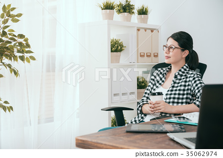 beautiful soho business woman holding coffee cup 35062974
