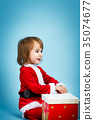 Happy toddler girl with Christmas gift box 35074677