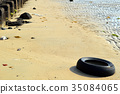 Sandy beach and scrap tires 35084065