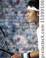ผู้ชายกำลังเล่นเทนนิส 35090506