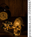 The skull is placed on a wooden table,  35096687
