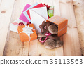 Gifts and envelopes on wooden table 35113563
