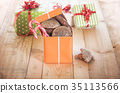 Opened gift box full of sweets 35113566