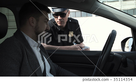 Policeman stopping a driver 35114354
