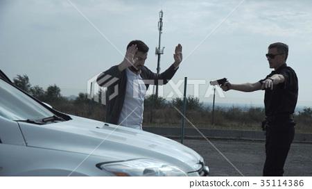 Policeman arresting delinquent 35114386