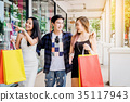 Shopping Asian friends are walking and shopping  35117943