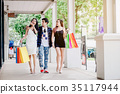 Shopping Asian friends are walking and shopping  35117944