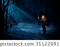 Scary witch in night forest 35122091