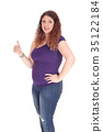 Curvy woman standing in profile with thump up 35122184