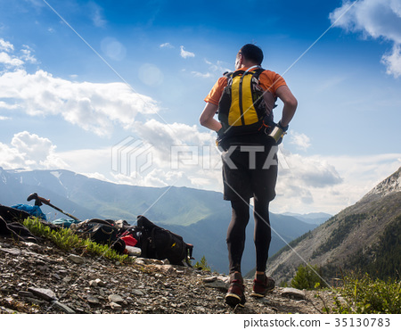Man trail running in the mountain in Altai, Russia 35130783