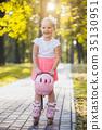 happy Little girl on roller skates at park 35130951