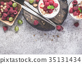 Fresh raspberry berries with yogurt in glasses 35131434